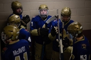 Notre Dame Preparatory High School Junior forward Adam Trupp waits near the rink entrance with his teammates in the moments building up to their game against Pinnacle High School Sunday, Nov. 4. at Ice Den Scottsdale. (Photo by Kailey Broussard)