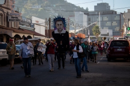 Nearly 200 protesters march towards the U.S.-Mexico border at Nogales, Sonora, Mexico, as part of the School of the America's Watch Border Encuentro Saturday, Nov. 17, 2018. The weekend event was centered around border demilitarization and protesting American imperialism. (Photo by Kailey Broussard)