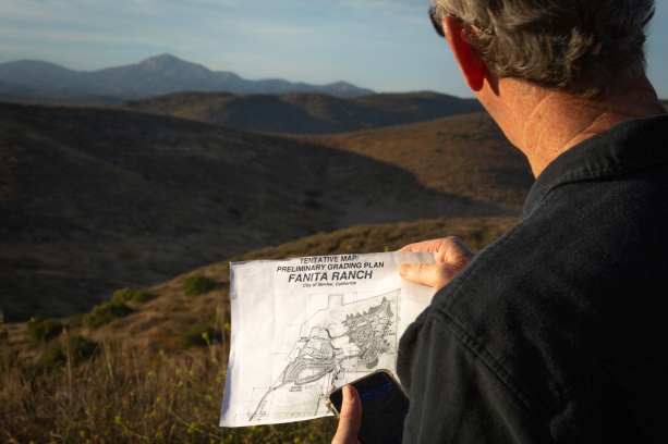 Van Collinsworth, a longtime California Department of Forestry and Fire Protection firefighter, maps the proposed layout of Fanita Ranch, a development approved in Santee, California. The development has gone back and forth between planning and legal battles for around a decade. Initially approved in 2007, but its environmental impact reports were found inadequate in 2013. (Kailey Broussard/News21)