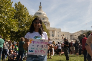 Amritha Karthikeyan, a senior BASIS Phoenix student and member of Arizona Youth Climate Strike, holds her sign in front of the Capitol building Friday, Sept. 20, 2019. (Photo by Kailey Broussard)