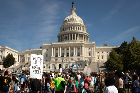Protesters hold up signs during D.C.'s Youth Climate Strike Friday, Sept. 20, 2019. (Kailey Broussard/Cronkite News)