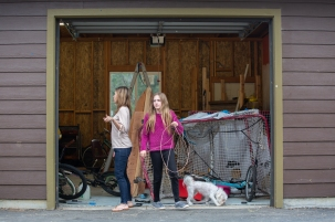 Angelique Hartman, left, and Lily, right, move about in their shed in Elfin Forest, Calif., June 30, 2019. The shed has been rebuilt since the 2014 Cocos fire burned it down. (Kailey Broussard)