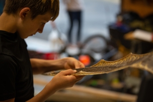 Cole admires the skin of a snake he killed with a shovel in his parents' yard. (Kailey Broussard)
