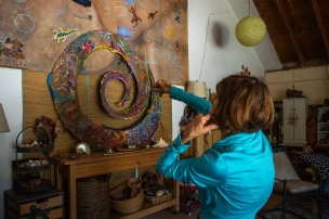 In the studio attached to her house, Lali Mitchell houses art pieces that incorporate the community. Mitchell lost much of her art in the 2014 Cocos Fire, including a $10,000 stained glass art collection. (Photo by Kailey Broussard / News21)